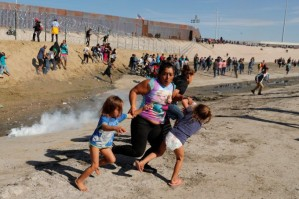 Mexican children fleeing tear gas. (Kim Kyung-Hoon/Reuters)